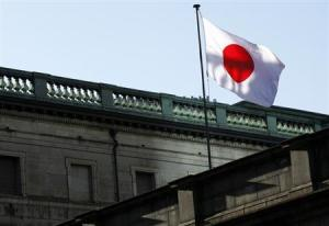 A Japanese national flag is hoisted at Bank of Japan headquarters in Tokyo
